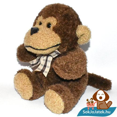 Joe, a csokornyakkendős plüss majom balról