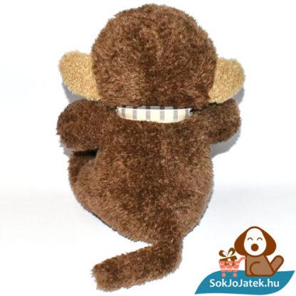 Joe, a csokornyakkendős plüss majom hátulról